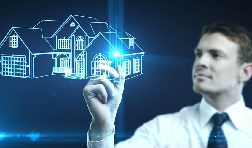 empresario dibuja la imagen de la casa, concepto de bienes raíces
