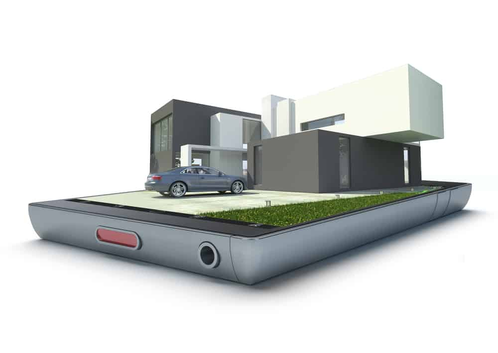 Edificio en 3d con coche encima de un teléfono móvil